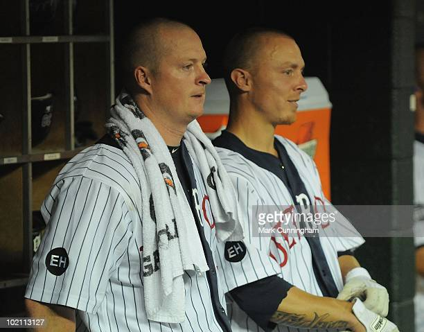 Jeremy Bonderman and Brandon Inge of the Detroit Tigers look on from the dugout while wearing Detroit Stars Negro League Tribute uniforms during the...