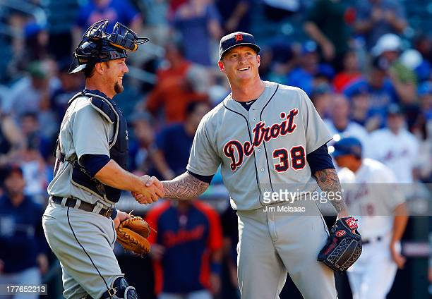 Jeremy Bonderman and Bryan Holaday of the Detroit Tigers celebrate after defeating the New York Mets at Citi Field on August 25 2013 in the Flushing...