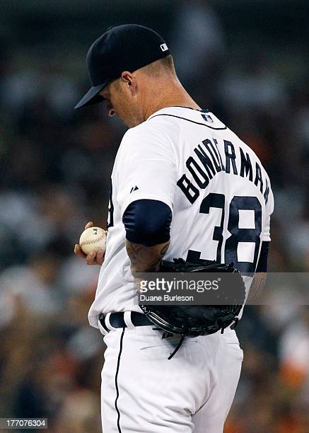 Jeremy Bonderman of the Detroit Tigers stands on the mound after giving up a solo home run to Pedro Florimon of the Minnesota Twins in the sixth...
