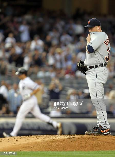 Jeremy Bonderman of the Detroit Tigers wipes his face as Mark Teixeira of the New York Yankees rounds the bases at Yankee Stadium on August 18 2010...