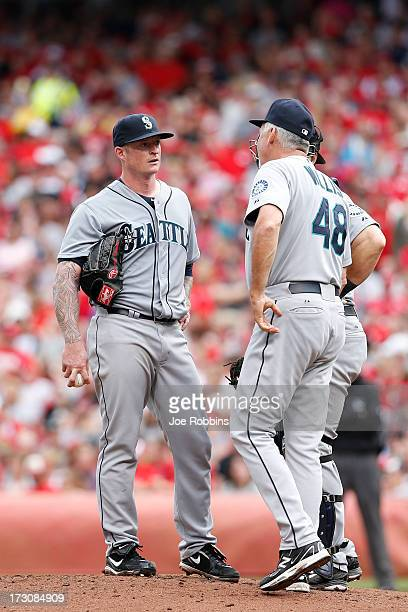 Jeremy Bonderman of the Seattle Mariners talks with pitching coach Carl Willis during the interleague game against the Cincinnati Reds at Great...