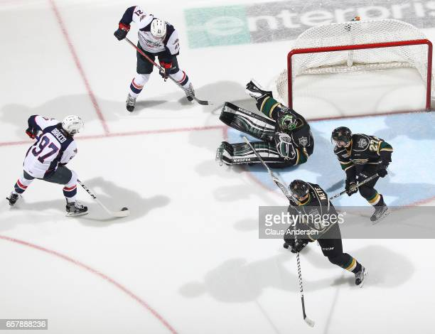 Jeremy Bracco of the Windsor Spitfires tries to get a shot at a fallen Tyler Parsons of the London Knights during Game One of the OHL Western...