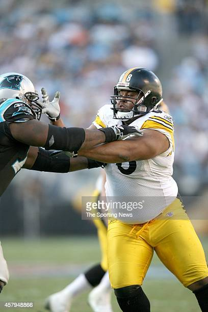 Jeremy Bridges of the Carolina Panthers fights Casey Hampton of the Pittsburgh Steelers during a game on December 17 2006 at the Bank of America...