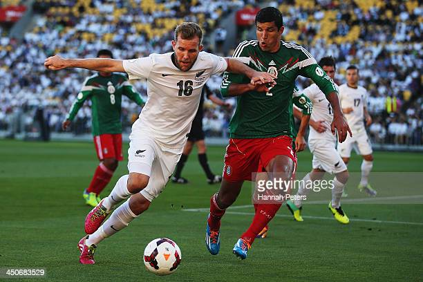 Jeremy Brockie of New Zealand competes with Francisco Javier Rodriguez of Mexico for the ball during leg 2 of the FIFA World Cup Qualifier match...