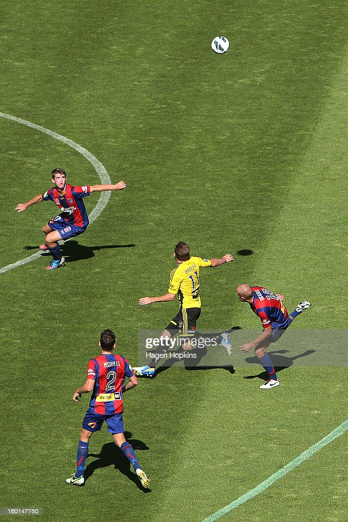 Jeremy Brockie of the Phoenix and Connor Chapman (L) of the Jets look to control a loose ball while teammates Scott Neville and Taylor Regan look on during the round 18 A-League match between the Wellington Phoenix and the Newcastle Jets at Westpac Stadium on January 27, 2013 in Wellington, New Zealand.