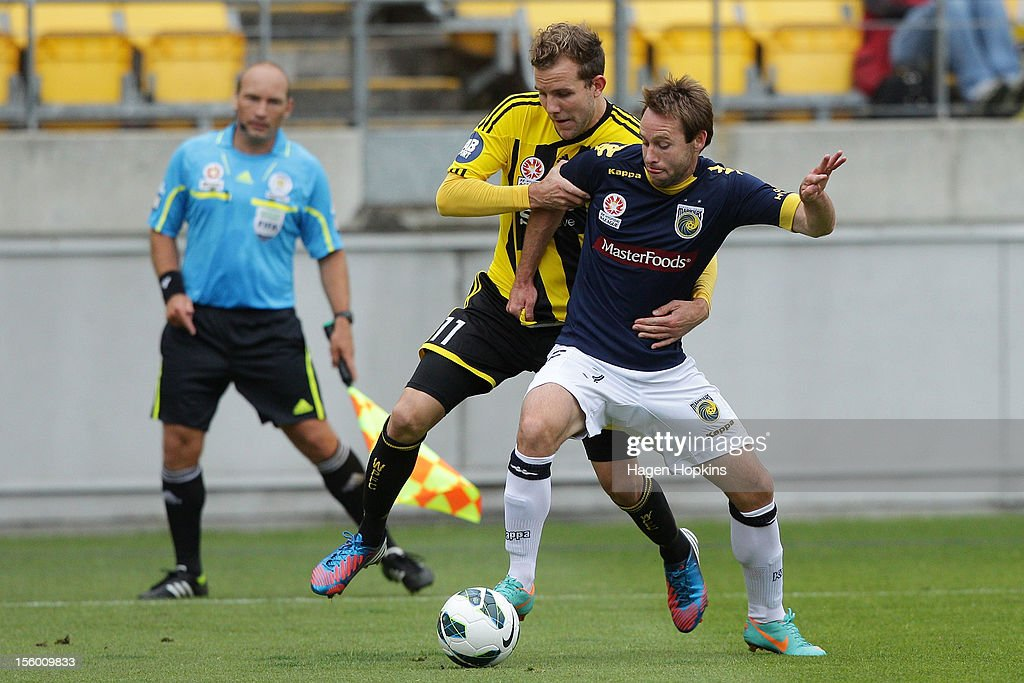 Jeremy Brockie of the Phoenix and Joshua Rose of the Mariners compete for the ball during the round six A-League match between the Wellington Phoenix and the Central Coast Mariners at Westpac Stadium on November 11, 2012 in Wellington, New Zealand.