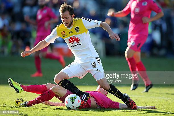 Jeremy Brockie of the Phoenix is brought down in the penalty box by Jacob Poscoliero of the Mariners during the round two A-League match between the...