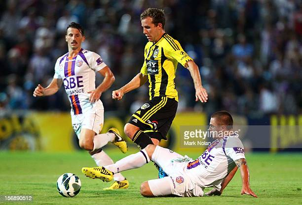 Jeremy Brockie of the Phoenix is tackled by Joshua Risdon of the Glory during the round eight A-League match between Perth Glory and Wellington...