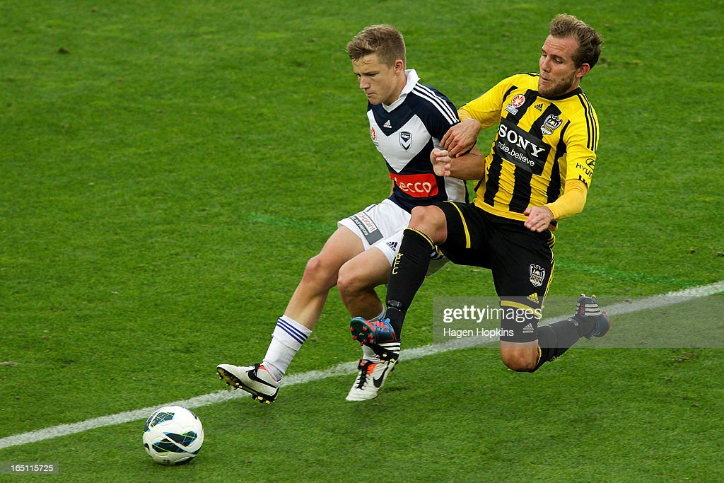 Jeremy Brockie of the Phoenix tackles Scott Galloway of the Victory during the round 27 A-League match between the Wellington Phoenix the Melbourne Victory at Westpac Stadium on March 31, 2013 in Wellington, New Zealand.