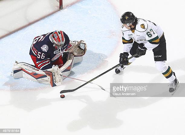 Jeremy Brodeur of the Oshawa Generals stops an in close attempt by Kole Sherwood of the London Knights during an OHL game at Budweiser Gardens on...