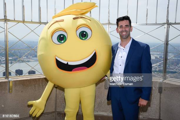 Jeremy Burge Founder of World Emoji Day poses for a photo together with a character from the film The Emoji Movie at The Empire State Building on...