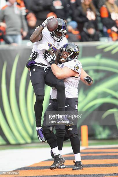 Jeremy Butler and Marshal Yanda of the Baltimore Ravens celebrate a touchdown during their game against the Cincinnati Bengals at Paul Brown Stadium...