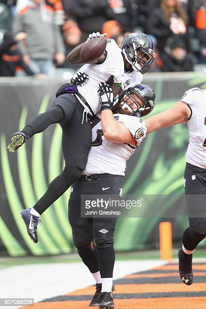Jeremy Butler and Marshal Yanda of the Baltimore Ravens celebrates a touchdown during their game against the Cincinnati Bengals at Paul Brown Stadium...
