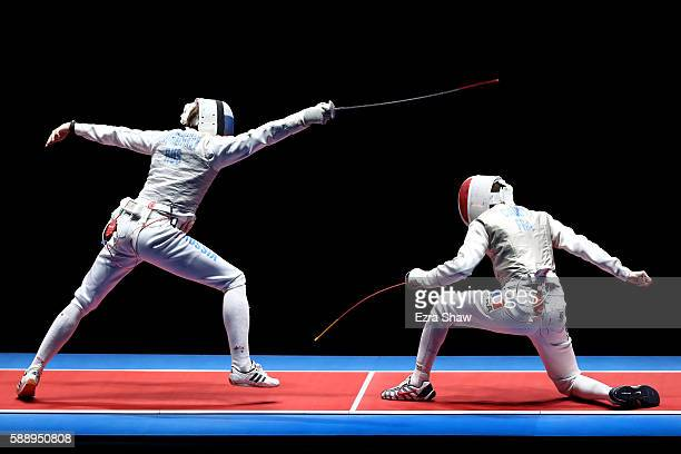 Jeremy Cadot of France competes against Alexey Cheremisinov of Russia during the Men's Foil Team Gold Medal Match bout on Day 7 of the Rio 2016...