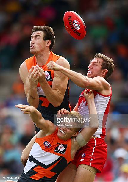 Jeremy Cameron and Adam Treloar of the Giants contest a mark during the NAB Challenge AFL match between the Greater Western Sydney Giants and the...