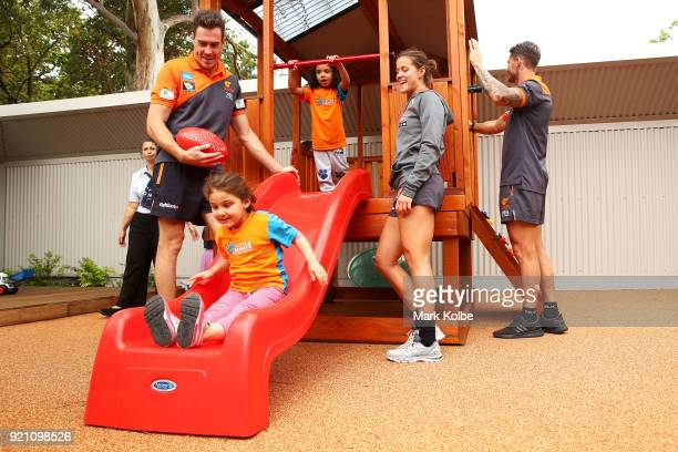 Jeremy Cameron Nicola Barr and Daniel Lloyd interact with children during a Greater Western Sydney Giants AFL media opportunity to launch their...