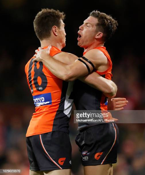 Jeremy Cameron of the Giants and Toby Greene of the Giants celebrate during the 2018 AFL Second Elimination Final match between the Sydney Swans and...