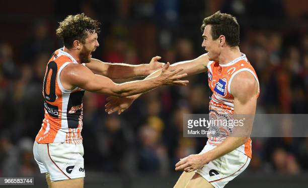 Jeremy Cameron of the Giants celebrates a goal with Sam J Reid of the Giants during the round 11 AFL match between the Adelaide Crows and the Greater...