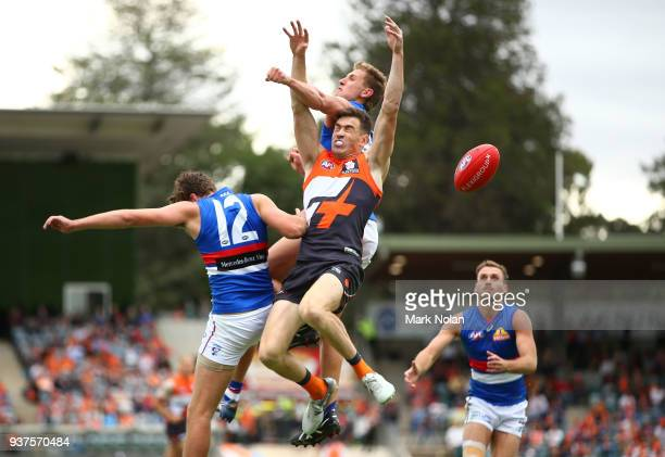 Jeremy Cameron of the Giants contest a mark during the round one AFL match between the Greater Western Sydney Giants and the Western Bulldogs at UNSW...