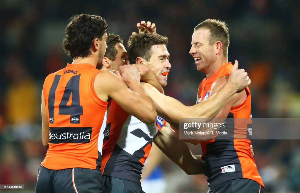 Jeremy Cameron of the Giants is congratulated by team mates after kicking a goal during the round six AFL match between the Greater Western Sydney Giants and the Western Bulldogs at UNSW Canberra Oval on April 28, 2017 in Canberra, Australia.