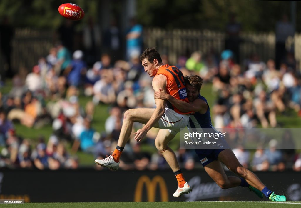 Jeremy Cameron of the Giants is tackled by Luke McDonald of the Kangaroos during the round three AFL match between the North Melbourne Kangaroos and the Greater Western Sydney Giants at Blundstone Arena on April 8, 2017 in Hobart, Australia.