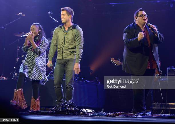 Jeremy Camp Jamie Grace and Sidewalk Prophets' David Frey perform at the 2nd Annual KLOVE Fan Awards at the Grand Ole Opry House on June 1 2014 in...