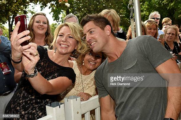 Jeremy Camp takes photos with fans at the 4th Annual KLOVE Fan Awards at The Grand Ole Opry House on June 5 2016 in Nashville Tennessee