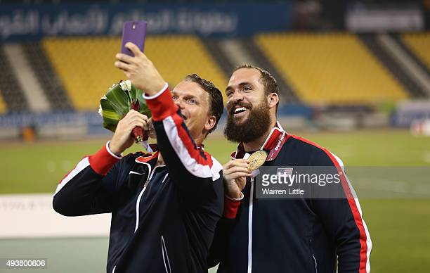 Jeremy Campbell of USA celebrates gold in the men's discus F44 with teammate David Blair as they take a selfie during the Evening Session on Day One...