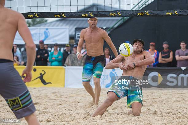 Jeremy Casebeer digs the ball as Casey Jennings looks on against Casey Patterson at the 2014 AVP Cincinnati Open on August 31 2014 at the Lindner...