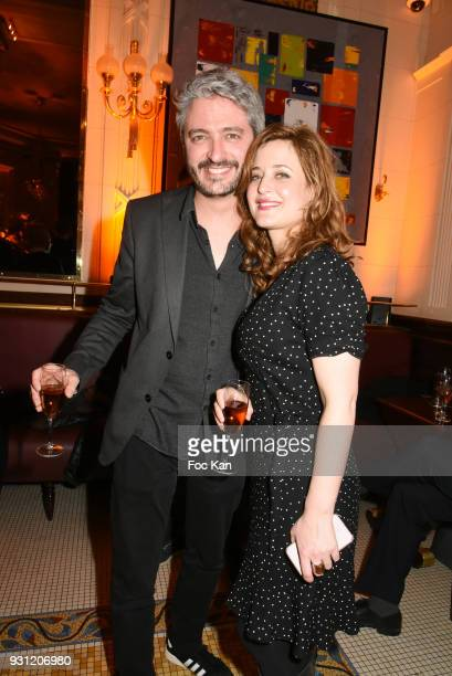 Jeremy Cerrone and Ariane Frier Ferrari attend Marc Cerrone Exhibition Preview at Deux Magots a on March 12 2018 in Paris France