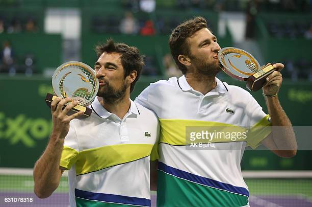 Jeremy Chardy and Fabrice Martin of France celebrate beating Vasek Pospisil of Canada and Radek Stepanek of Czech Republic in their doubles final...