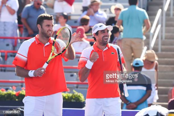 Jeremy Chardy and Fabrice Martin of France celebrate their 67 57 victory over Felix AugerAliassime and Vasek Pospisil of Canada during day 4 of the...