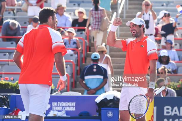 Jeremy Chardy and Fabrice Martin of France celebrate their 6-7, 5-7 victory over Felix Auger-Aliassime and Vasek Pospisil of Canada during day 4 of...