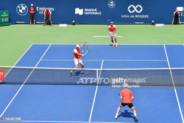 Jeremy Chardy and Fabrice Martin of France compete in their doubles match against Rajeev Ram of the United States and Joe Salisbury of Great Britain...