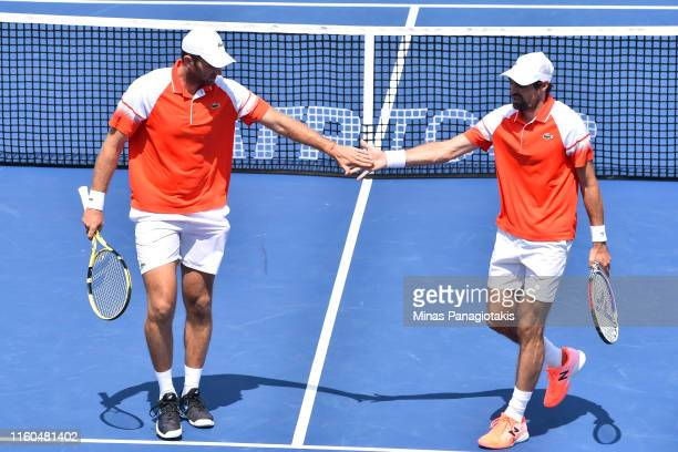 Jeremy Chardy and Fabrice Martin of France congratulate one another in their doubles match against Rajeev Ram of the United States and Joe Salisbury...