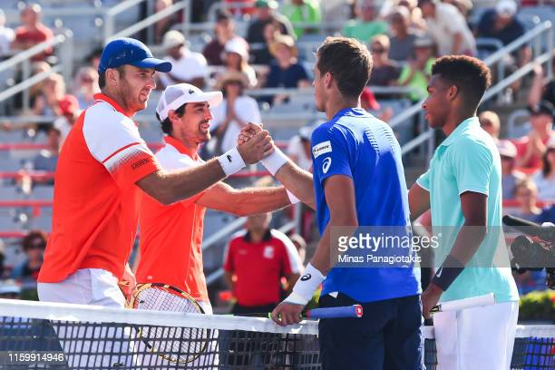 Jeremy Chardy and Fabrice Martin of France show respect against Felix Auger-Aliassime and Vasek Pospisil of Canada after defeating them 6-7, 5-7 in...