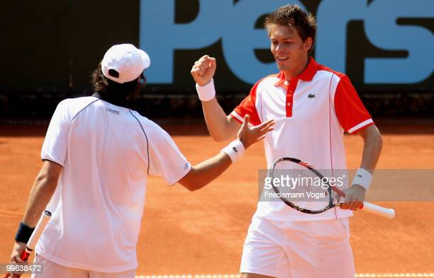 Jeremy Chardy and Nicolas Mahut of France celebrates after winning their double match against Philip Kohlschreiber and Christopher Kas of Germany...
