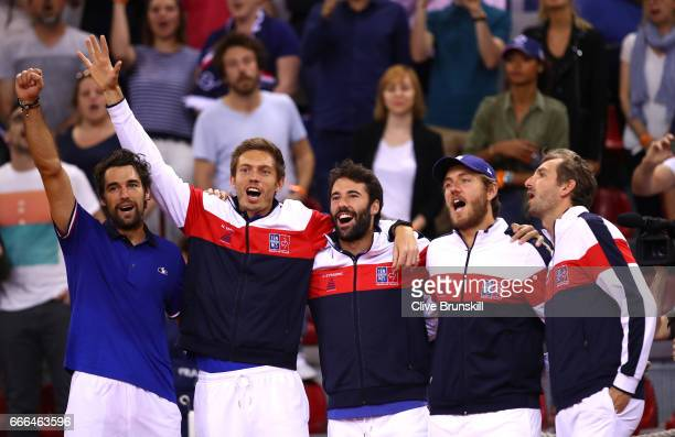 Jeremy Chardy, Nicolas Mahut, Jonathan Eysseric, Lucas Pouille and Julien Benneteau of France celebrate their victory against Great Britain on day 3...