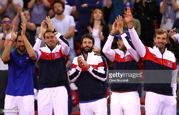 Jeremy Chardy Nicolas Mahut Jonathan Eysseric Lucas Pouille and Julien Benneteau of France celebrate their victory against Great Britain on day 3 of...