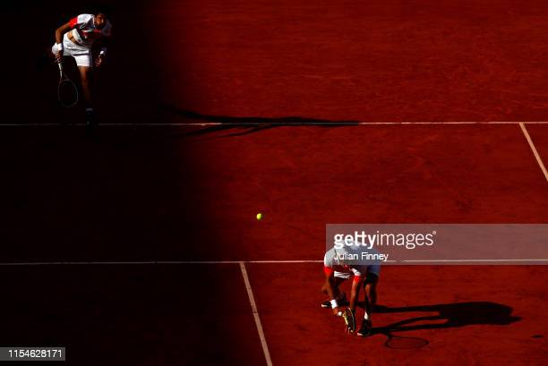 Jeremy Chardy of France and Fabrice Martin of France serves during the mens doubles final against Kevin Krawietz of Germany and partner Andreas Mies...