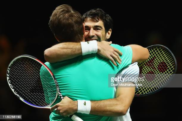 Jeremy Chardy of France and Henri Kontinen of Finland celebrate victory against Jean-Julien Rojer of the Netherlands and Horia Tecau of Romania after...