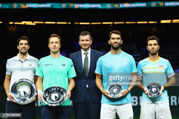 Jeremy Chardy of France and Henri Kontinen of Finland celebrate victory with the trophies against Jean-Julien Rojer of the Netherlands and Horia...