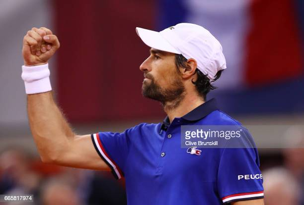 Jeremy Chardy of France celebrates victory during the singles match against Daniel Evans of Great Britain on day one of the Davis Cup World Group...