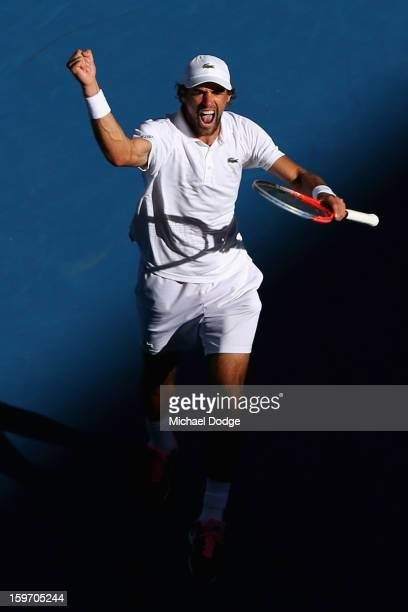 Jeremy Chardy of France celebrates winning his third round match against Juan Martin Del Potro of Argentina during day six of the 2013 Australian...