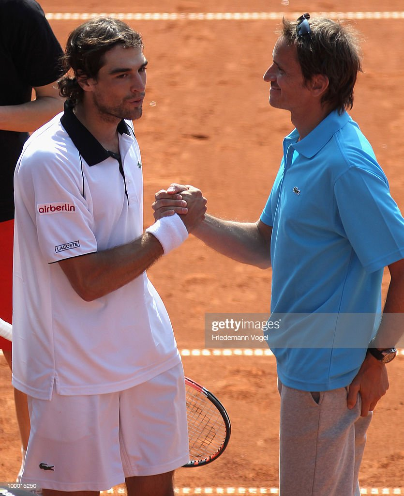 Jeremy Chardy of France celebrates with coach Frederic Fontang after winning his match against Juan Monaco of Argentina during day five of the ARAG World Team Cup at the Rochusclub on May 20, 2010 in Duesseldorf, Germany.