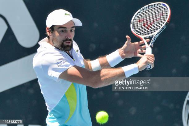 Jeremy Chardy of France hits a return against compatriot Gilles Simon during their men's singles first round match at the Adelaide International...