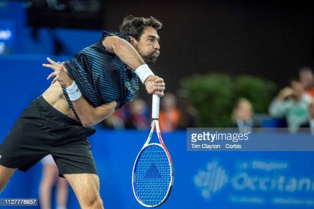 Jeremy Chardy of France in action against Antoine Hoang of France during the Open Sud de France Tennis Tournament at the Sud de France Arena on...