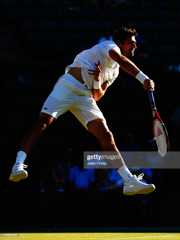 Jeremy Chardy of France in action in his Gentlemens Singles first round match against Tomas Berdych of Czech Republic during day two of the Wimbledon Lawn Tennis Championships at the All England Lawn Tennis and Croquet Club on June 30, 2015 in London, England.