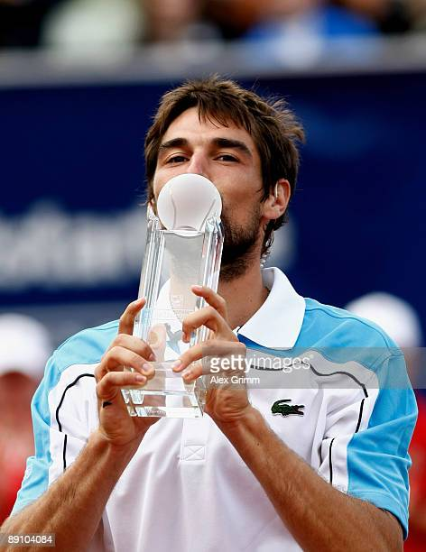 Jeremy Chardy of France presents the winner's trophy after defeating Victor Hanescu of Romania in the final of the MercedesCup at the TC Weissenhof...