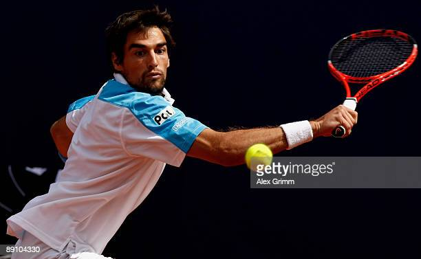 Jeremy Chardy of France returns the ball to Victor Hanescuof Romania during the final match of the MercedesCup at the TC Weissenhof on July 19 2009...